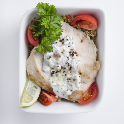 Grilled chicken salad in white dish