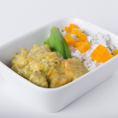 Curry in white cup with rice