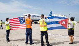 US and Cuba flags held by ground crew