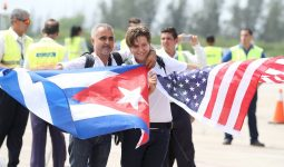 Man and boy holding flags