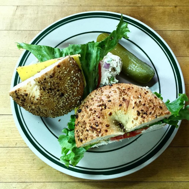Sandwich on bagel with pickle