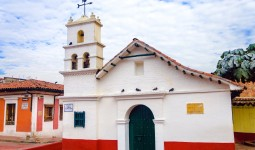 Old white historic church in La Candelaria neighborhood of Bogota, Colombia