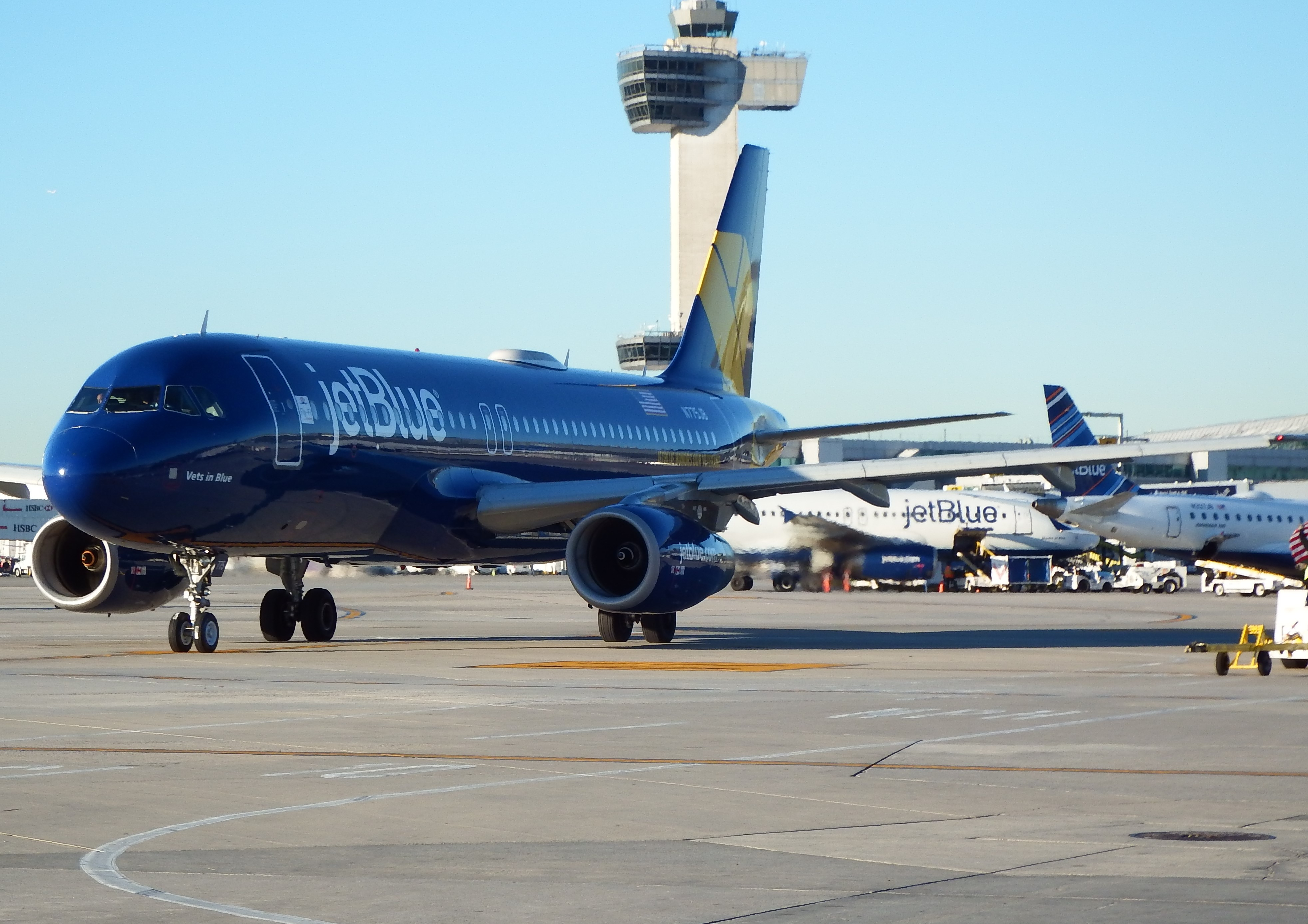 jetBlue airplane on runway with control tower