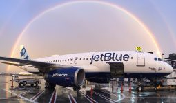 jetBlue plane with perfect rainbow