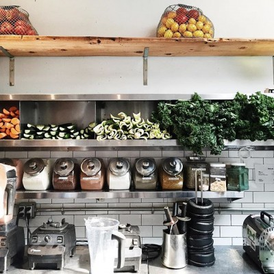 Wall with shelves and ingredients in kitchen