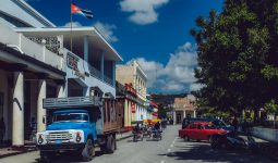 Old soviet truck parked in front of administrative building in Holguin, Cuba