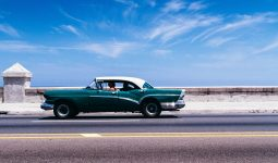 Classic car on roadway with sky