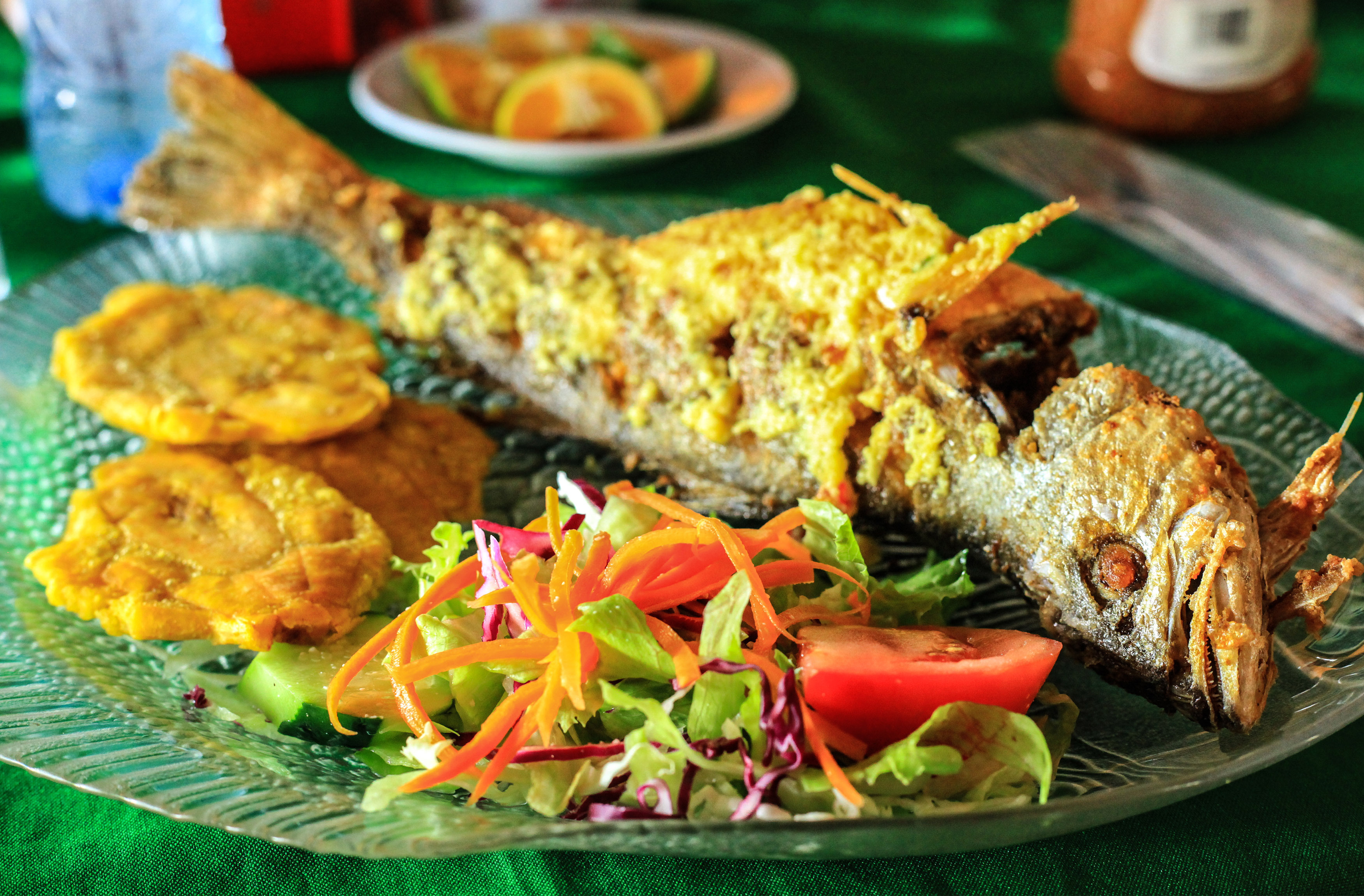 Whole fried fish with salad