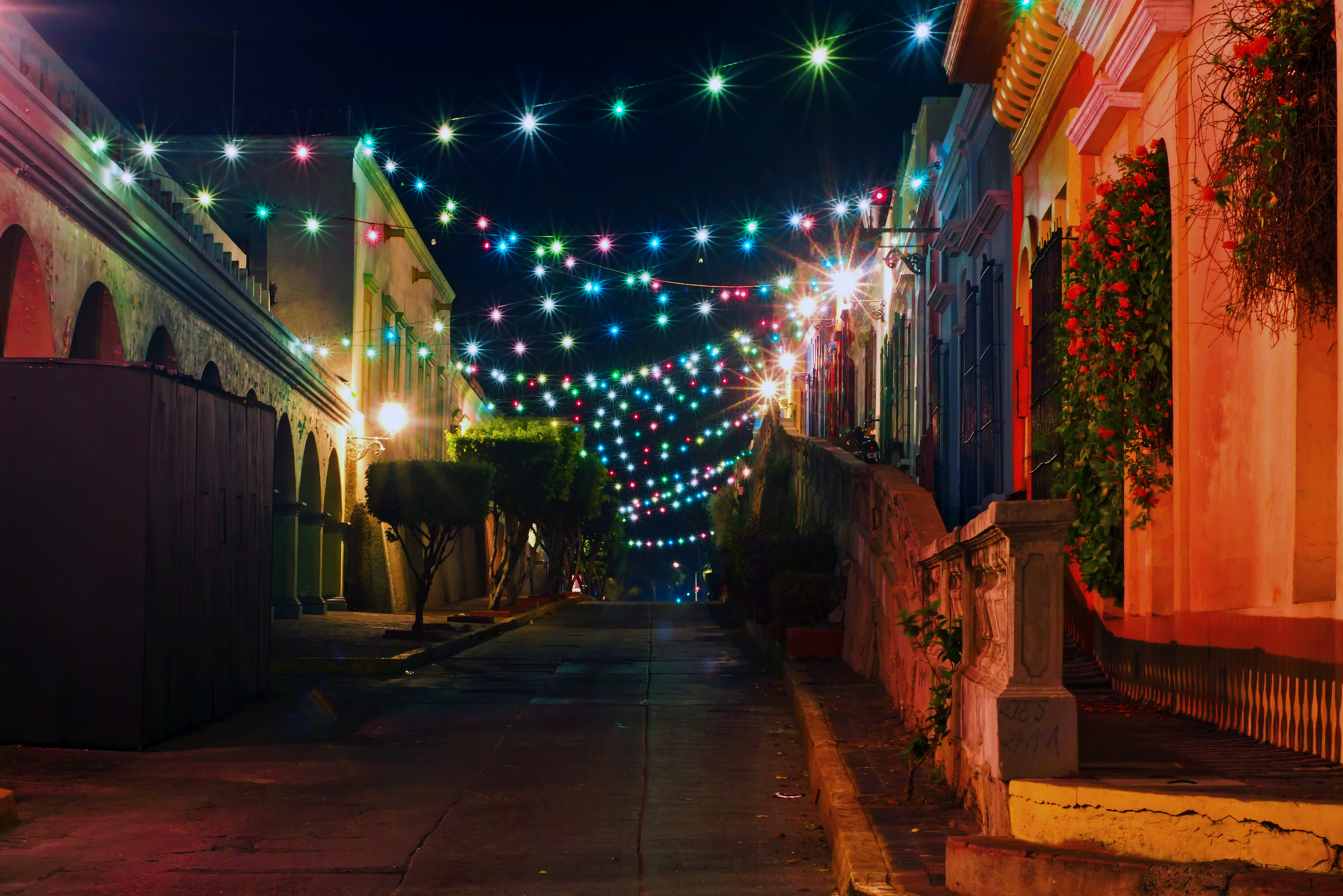 Empty alley with lights at night